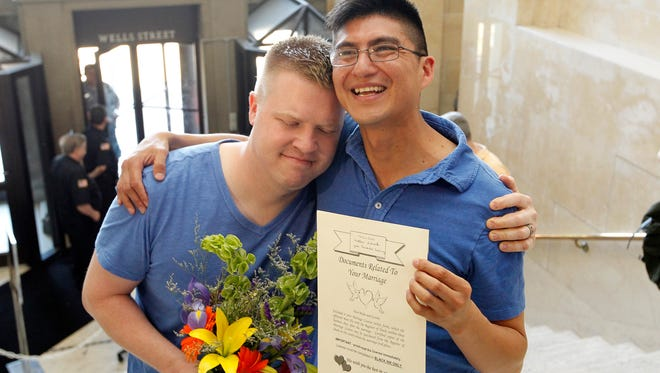 Matt Schrek (left) and Jose Fernando Guitterez were the first couple to get married at the Milwaukee County Courthouse after the ban on same sex marriage was revoked in June 2014. The state would discontinue state health coverage and other benefits for thousands of domestic partners of state and local workers, arguing that such partnerships are no longer necessary because same-sex marriage is legal.
