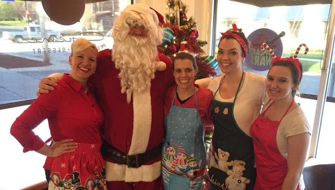 From left: Christina Moffatt, Santa Claus, Corrine Beers, Alyx Birmingham and Kaylee Schoon