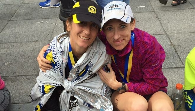 Chambersburg's Laurie Dymond, left, and Jill  Hazelton pose for a photo after completing Monday's Boston Marathon. Hazelton finished the race in 3:30:33 while Dymond crossed the line in 3:38:46.
