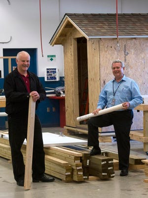 Dan Busse, dean of workforce education, left, and Danny Steele, director of applied technology and professional services, right, at Pensacola State College have created a new carpentry program at PSC to helps the building tiny houses. The new program is set to launch in Jan. 2016.