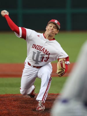 Cal Krueger pitches against the University of Evansville during a game on March 28 in Bloomington.