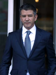 Former Uber CEO Travis Kalanick leaves the Phillip Burton Federal Building on day three of the dispute between Waymo and Uber Technologies on Feb. 7 in San Francisco.