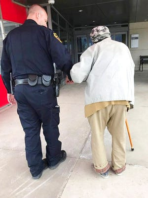 In this April 19, 2018, photo provided by the Montoursville Police Department in Montoursville, Pa., Jason Bentley, left, deputy chief of the department, escorts an 84-year-old man to see his wife, also 84, in the emergency department of UPMC Susquehanna hospital in Williamsport, Pa. After the elderly man's wife had a medical emergency and was taken from the couple's home by ambulance, Montoursville Police Chief Jeff Gyurina said he gave the man a patrol car's cellphone number because the man couldn't drive anymore and had no family in the area to take him to the hospital.