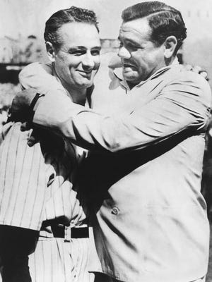 Babe Ruth, right, immortal New York Yankee baseball player comforts Lou Gehrig, who was almost too moved to speak to the vast throng which acclaimed him at Yankee Stadium on July 4, 1939, where the Yankees met the Washington Senators in a doubleheader. Gehrig, famed iron man of the Yankees, was honored by players and fans. As an added honor, the world championship flag that the Yankees won in 1927 with a team hailed as one of baseball's greatest was unfurled at the stadium.