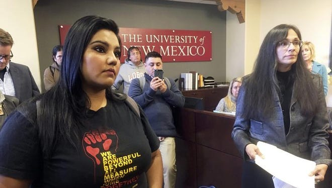 "In this Nov. 18, 2016 file photo, University of New Mexico student LuzHilda Campos, left, and Chicana and Chicano studies professor Irene Vasquez, right, present a letter with hundreds of signatures to school president Bob Frank, asking him to declare the campus a ""sanctuary university,"" in Albuquerque. Universities and colleges in several states are considering labeling themselves ""sanctuary campuses"" amid fears from immigrant students and pressure from activists following the election of Donald Trump."