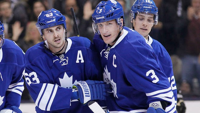 Maple Leafs defenseman Dion Phaneuf, right, congratulates forward Dave Bolland after scoring against the Penguins during the first period at the Air Canada Centre.