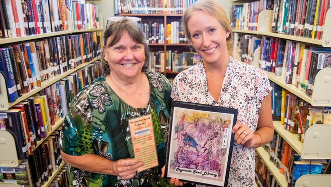 Jackie Hardin, left, and Seymour branch manager Sarah McBride with the library's new seed library on Wednesday, May 23, 2018.