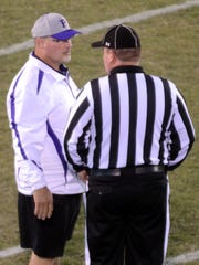Portland High head coach Greg Cavanah talks to an official