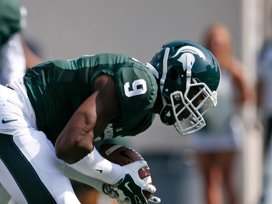 Michigan State defensive back Montae Nicholson picks up a loose ball during the second quarter against the Eastern Michigan.