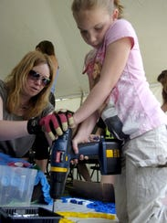 The KidzArt tent is a popular place during the annual