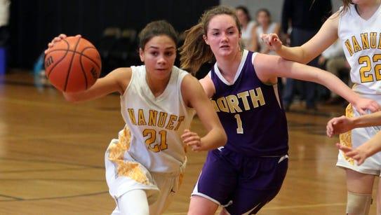 Nanuet's Zoe Amalbert drives the ball past Clarkstown