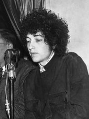 In this May 22, 1966 file photo, Bob Dylan gestures