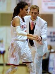 Sweetwater head coach Rusty Rainbolt  congratulates