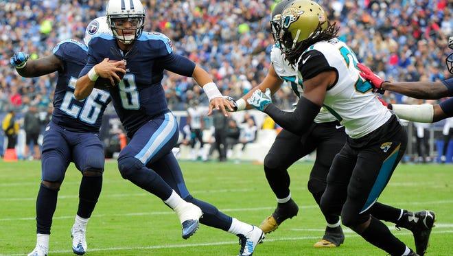 Titans quarterback Marcus Mariota scrambles out of the pocket against the Jaguars last Sunday.
