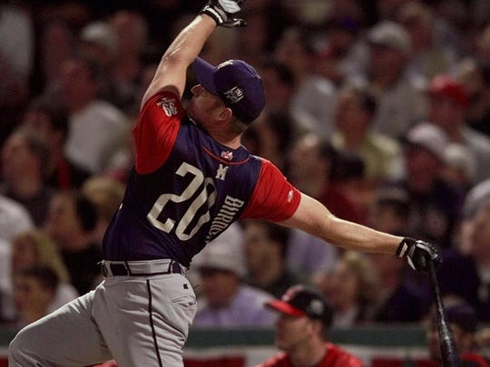 Milwaukee Brewers' Jeromy Burnitz follows through on one of six home runs during the first round of the All-Star hitting contest at Boston's Fenway Park Monday, July 12, 1999.