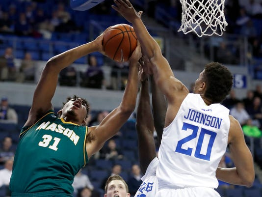 George Mason's Jalen Jenkins (31) heads to the basket as Saint Louis' Jalen Johnson (20) defends during the first half of an NCAA college basketball game Wednesday, Feb. 1, 2017, in St. Louis. (AP Photo/Jeff Roberson)