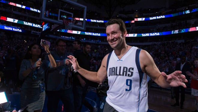 Former Dallas Cowboys quarterback Tony Romo (9) is introduced before the Dallas Mavericks game against the Denver Nuggets at the American Airlines Center.