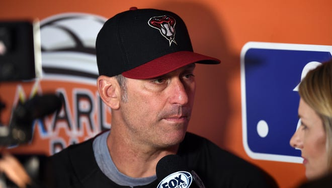 Jun 1, 2017; Miami, FL, USA; Arizona Diamondbacks manager Torey Lovullo (17) fields questions from a reporter in the dugout before a game against the Miami Marlins at Marlins Park.