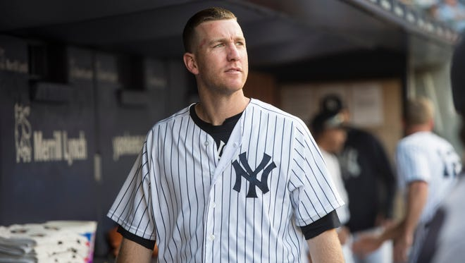 Aug 1, 2017; Bronx, NY, USA; New York Yankees third baseman Todd Frazier (29) look on from the dugout prior to the game against the Detroit Tigers at Yankee Stadium. Mandatory Credit: Gregory J. Fisher-USA TODAY Sports