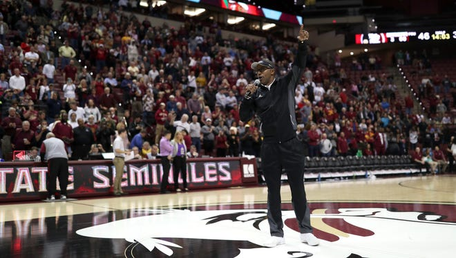 FSU's new Head Football Coach Willie Taggart speaks to the fans during halftime of the Seminoles game against Loyola of Maryland at the Tucker Civic Center on Wednesday, Dec. 6, 2017.