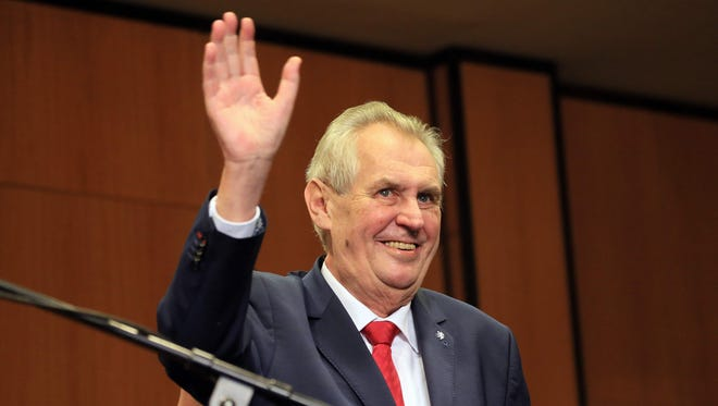 Pro-Russian incumbent Milos Zeman waves as he arrives to celebrate his victory with his staff members after he was reelected Czech President on Jan. 27, 2018 at the Top hotel in Prague.