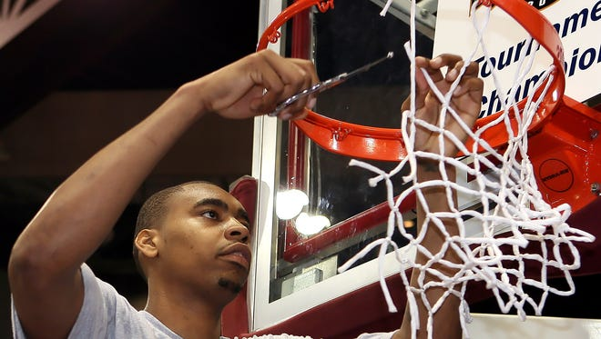 Texas A&M-Corpus Christi's Chris Daniels cuts down the net as the Islanders win the Southland Conference Tournament and advance to the NCAA Tournament. It was the Islanders first appearance at the NCAA Tournament.