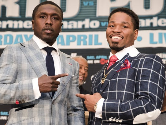 Andre Berto, left, and Shawn Porter pose after their