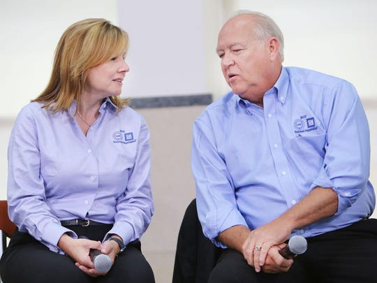 Following the ceremonial handshake between General Motors and United Auto Workers Monday, July 13, 2015 at the UAW-GM Center for Human Resources in Detroit, General Motors President Mary Barra, left, chats with UAW President Dennis Williams as they prepare to take questions from the media.