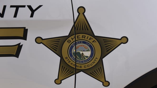 The Stearns County sheriff's badge on a vehicle.
