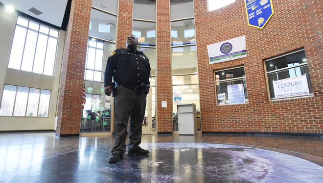 Maysville Local Schools resource officer John Howe waits for the bell to ring between classes in the atrium of Maysville's 8-12 building. Most of the time, after he makes a sweep of the campus in the mornings, Howe parks his cruiser directly in front of the school's main entrance. Maybe if someone sees a police car out front, they'll think twice about bringing a weapon into the school, he said.