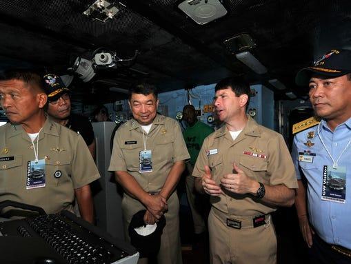 Rear Adm. Kevin Donegan, center right, commander of
