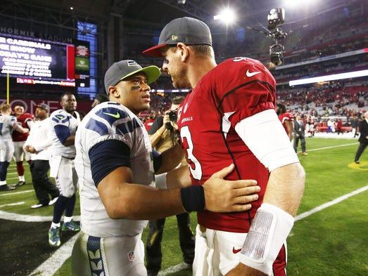 Arizona quarterback Carson Palmer congratulates Seattle