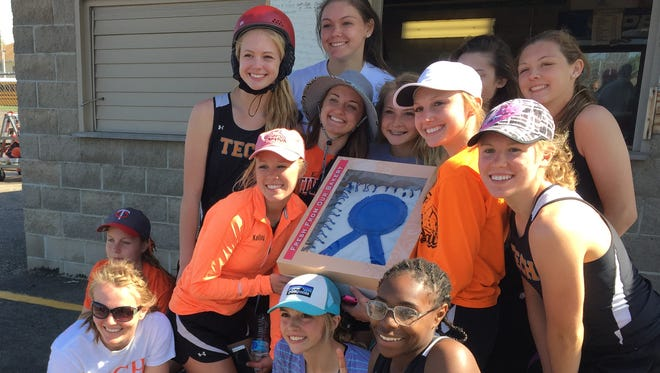 St. Cloud Tech poses with the Mega Meet cake after taking first place Saturday at Sauk Rapids.