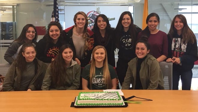 Centennial's Marin Smith, bottom second from right, signed to play volleyball for Adams State University on Thursday.