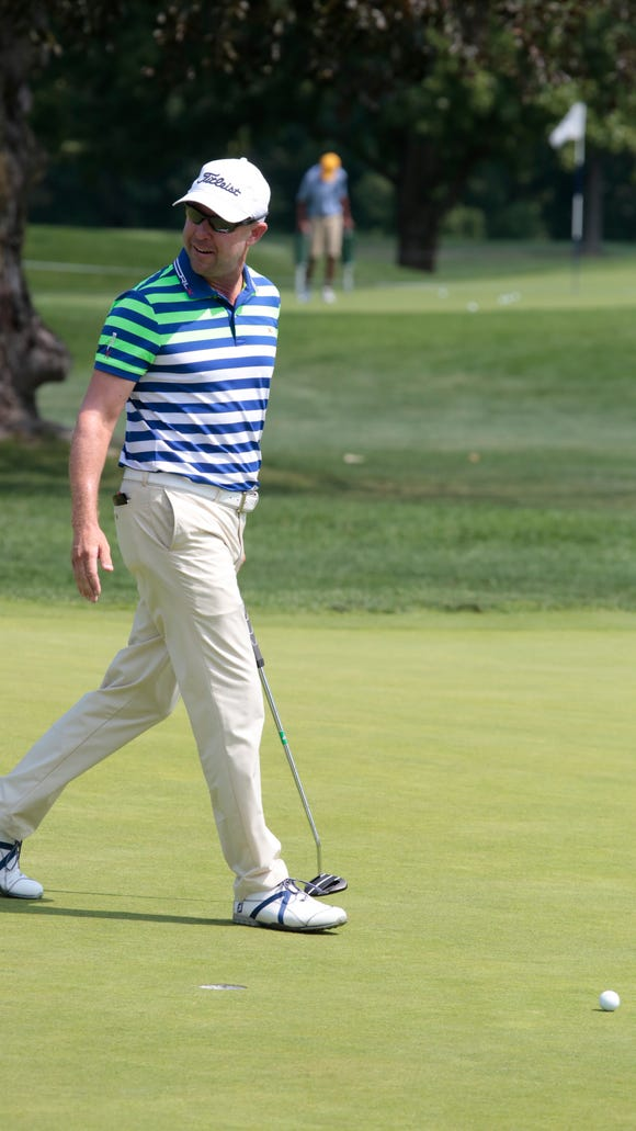 Rob Labritz from the Glenarbor Golf Club putts at the