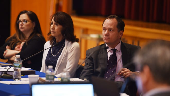 Board President Rob Francin, third from left, listens as Superintendent Dr. Richard Kuder (not shown) talks about the 3-2 Kindergarten Program for 2017-18 during a school board meeting at Eisenhower Middle school in Wyckoff on March 20, 2017.