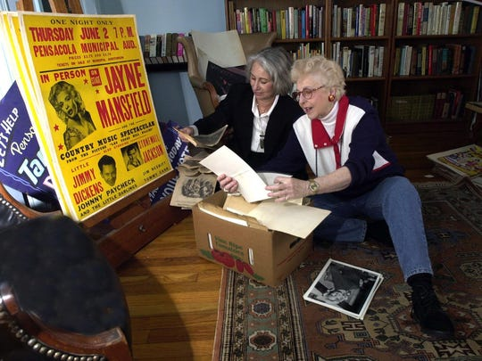 Taris Savell, right, and Helen Brown-Galloway look over some of the items that were to be sold at Savell's estate sale. Savell conducted the last interview with Jayne Mansfield before she was killed in a car accident.