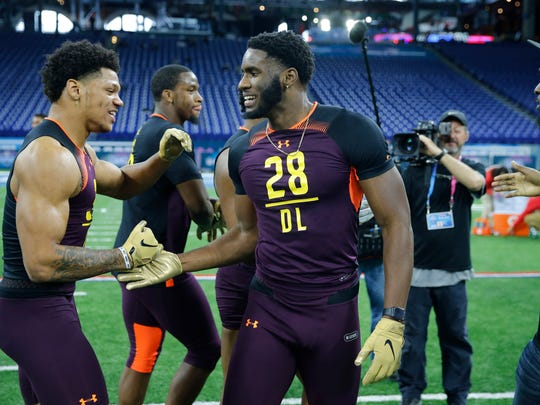 Mar 3, 2019; Indianapolis, IN, USA; Akron defensive lineman Jamal Davis (left) and Florida State defensive lineman Brian Burns (DL28) congratulate each other after finishing their workout drills during the 2019 NFL Combine at Lucas Oil Stadium. Mandatory Credit: Brian Spurlock-USA TODAY Sports