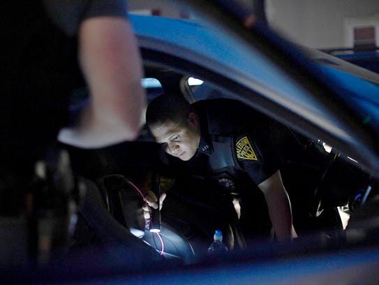 Haledon police officers search a car after detecting