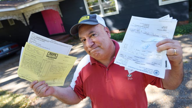 Francis Rullan keeps a file of his water bills, plumber reports and other related materials documenting issues with billing at his Belhaven home in Jackson dating to 2013.