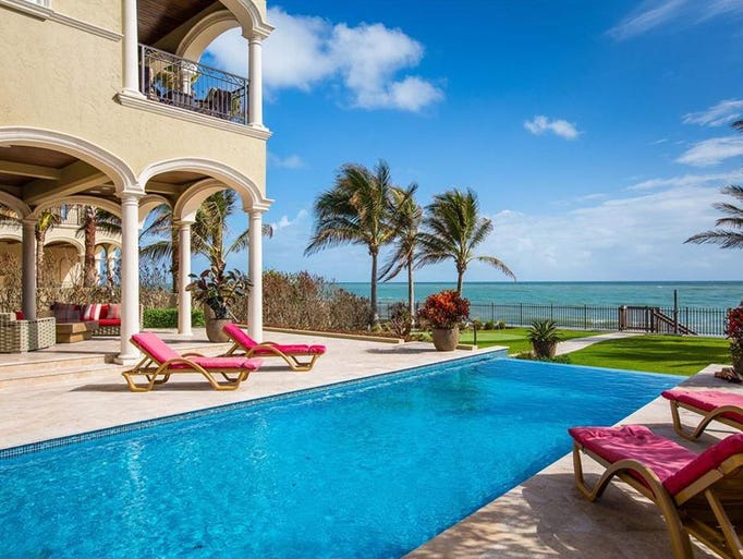 The pool and patio of this estate at 3636 Ocean Drive