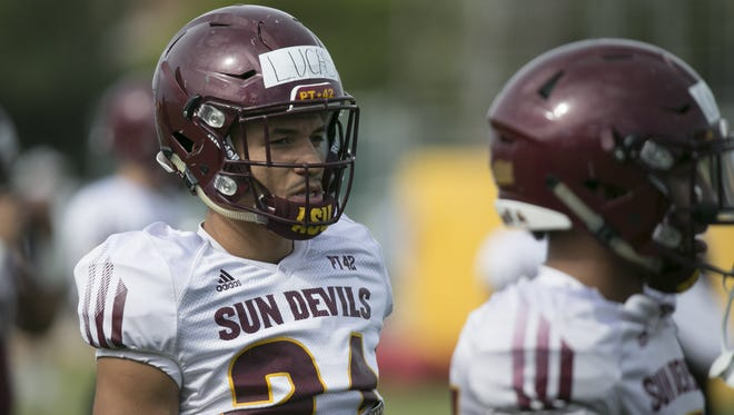 """I love the schemes and I feel like it's going to work. We're going to be a Top 10 defense in the country this year,"" ASU defensive back Chase Lucas (left) said."