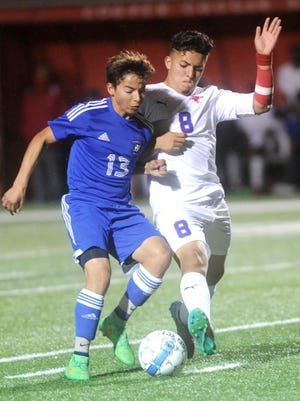 Joey D. Richards/Reporter-News Cooper's Pedro Lira (8) fights a San Angelo Lake View player for the ball. Lira scored three goals in the Cougars' 5-0 victory Tuesday at Shotwell Stadium. The win gave Cooper its second straight District 4-5A title.
