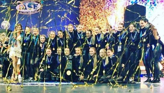 "Confetti drops on a team of dancers from Sheboygan's Dollhouse Dance Factory after they took first in a world competition for a hip-hop routine in the category of ""senior large."""