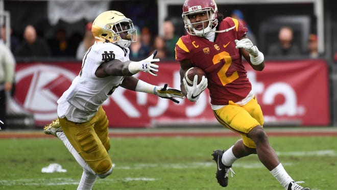 Nov 26, 2016; Los Angeles, CA, USA; Southern California Trojans defensive back Adoree Jackson (2) is pursued by Notre Dame Fighting Irish safety Jalen Elliott (21) on a 52-yard touchdown reception in the third quarter during a NCAA football game against the Notre Dame Fighting Irish at Los Angeles Memorial Coliseum. Mandatory Credit: Kirby Lee-USA TODAY Sports