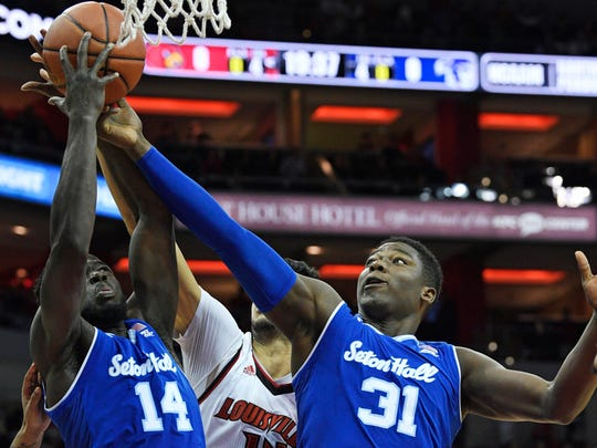Seton Hall Pirates center Angel Delgado (31) and forward