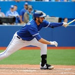 Blue Jays left fielder Chris Colabello hits a two-run