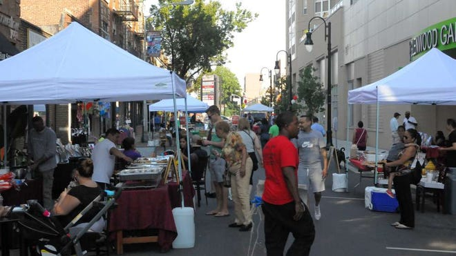 Visitors at a block party mingle and learn about Washington Street businesses in this 2016 file photo.