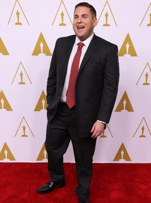 Jonah Hill hits the arrival red carpet for the 86th Oscar nominees luncheon.