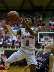 Bosse's Mekhi Lairy (2) drives to the net during the